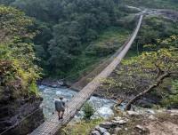 crossing-a suspension-bridge-during-trekking
